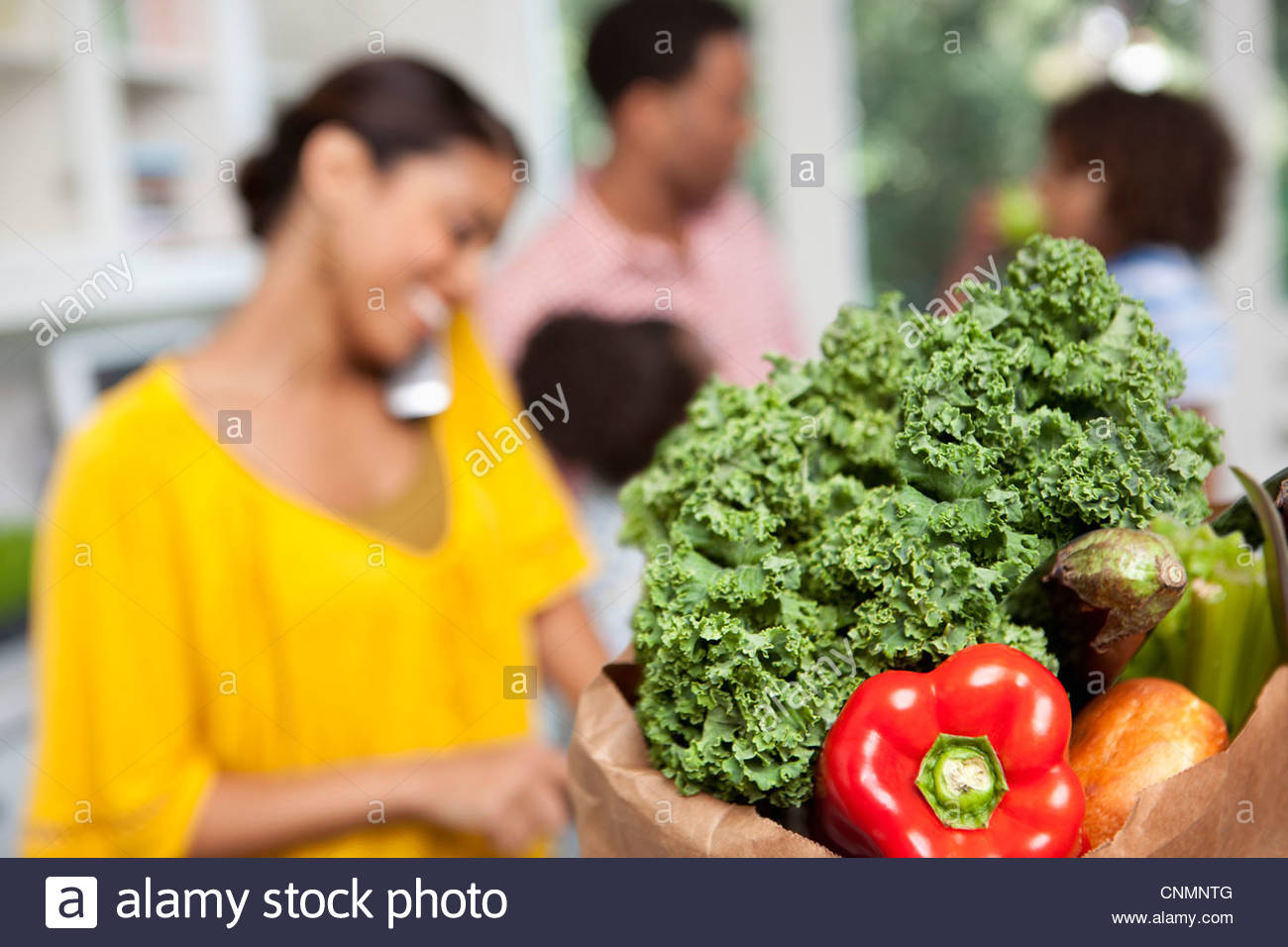 Close up of bag of groceries in kitchen - Stock Image