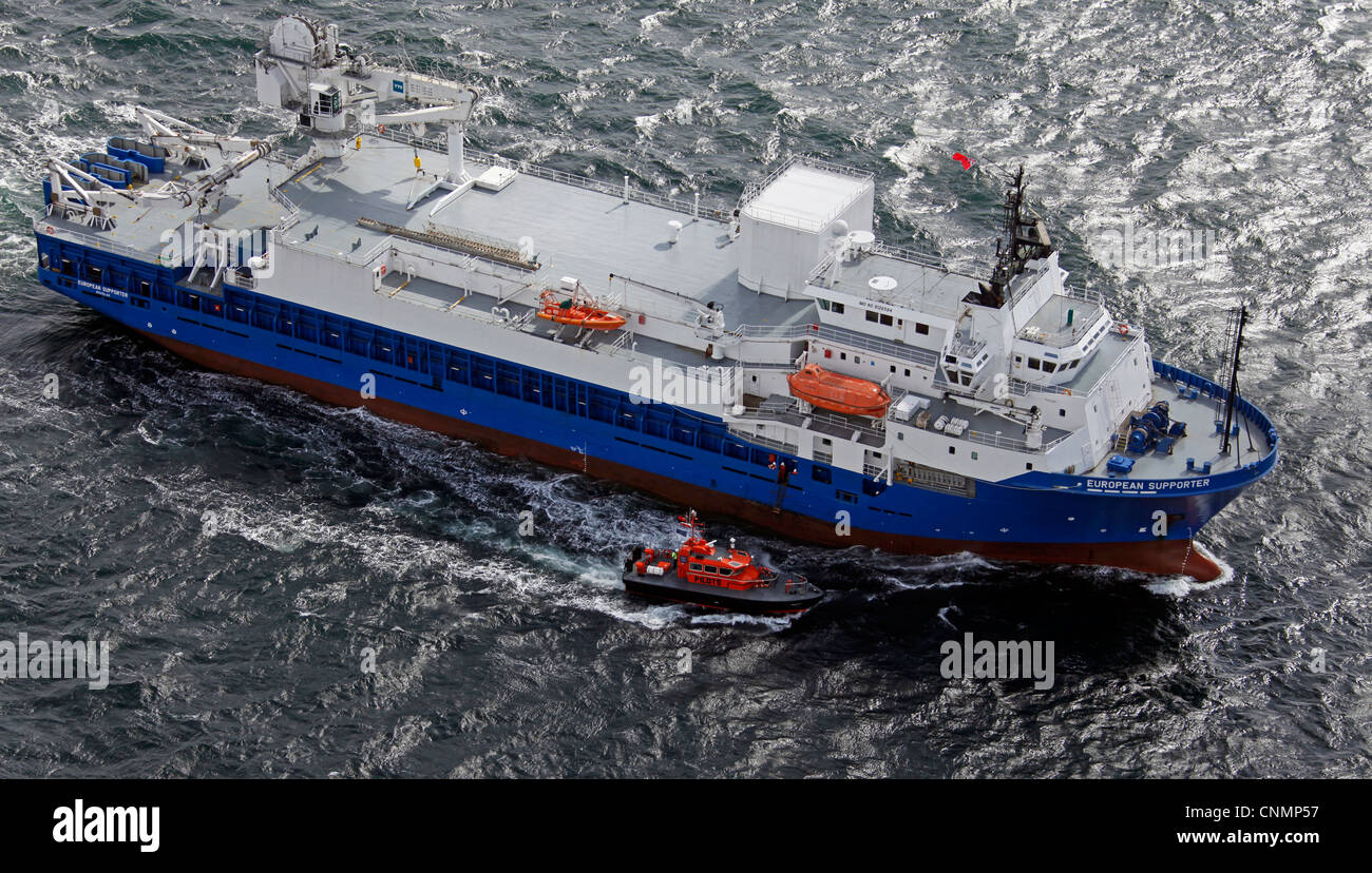 aerial view of a ship with pilot boat escort - Stock Image