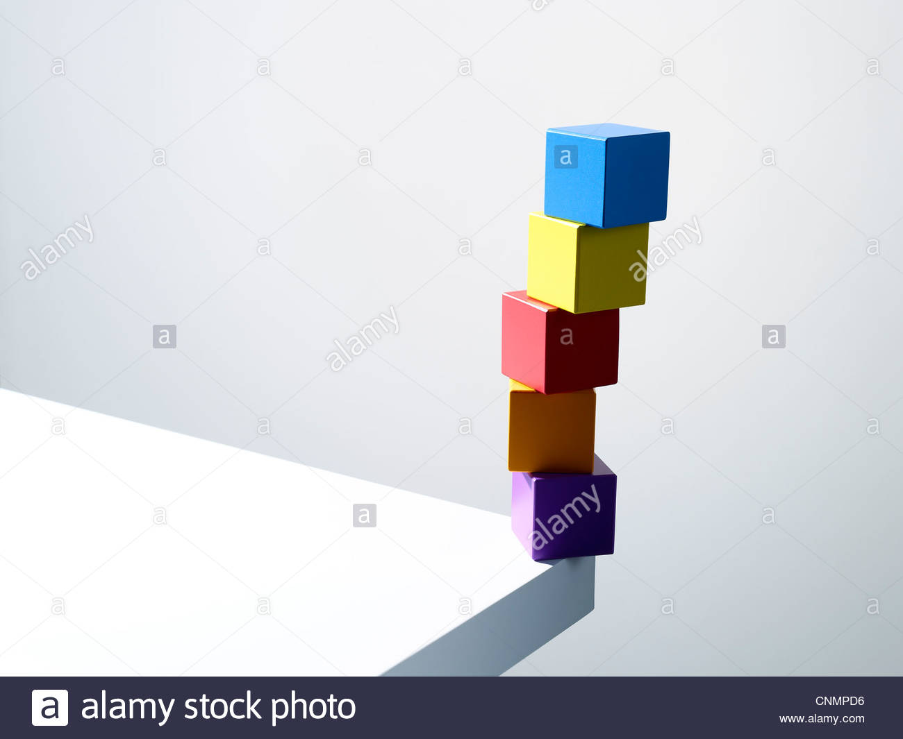 Stack of colorful cubes on table corner - Stock Image