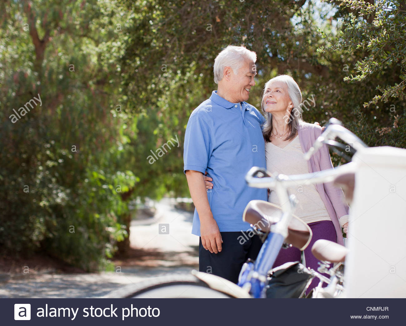 two older women cycling stock photos & two older women cycling stock