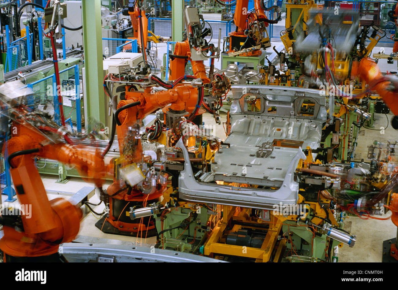 robots welding in a car factory - Stock Image