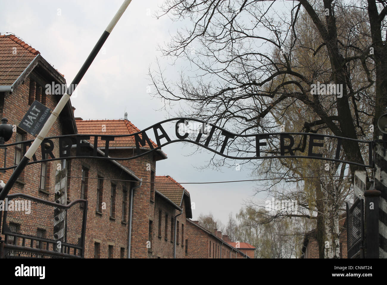 Arbeit Macht Frei is displayed over the entrance to Auschwitz Camp in Poland. - Stock Image