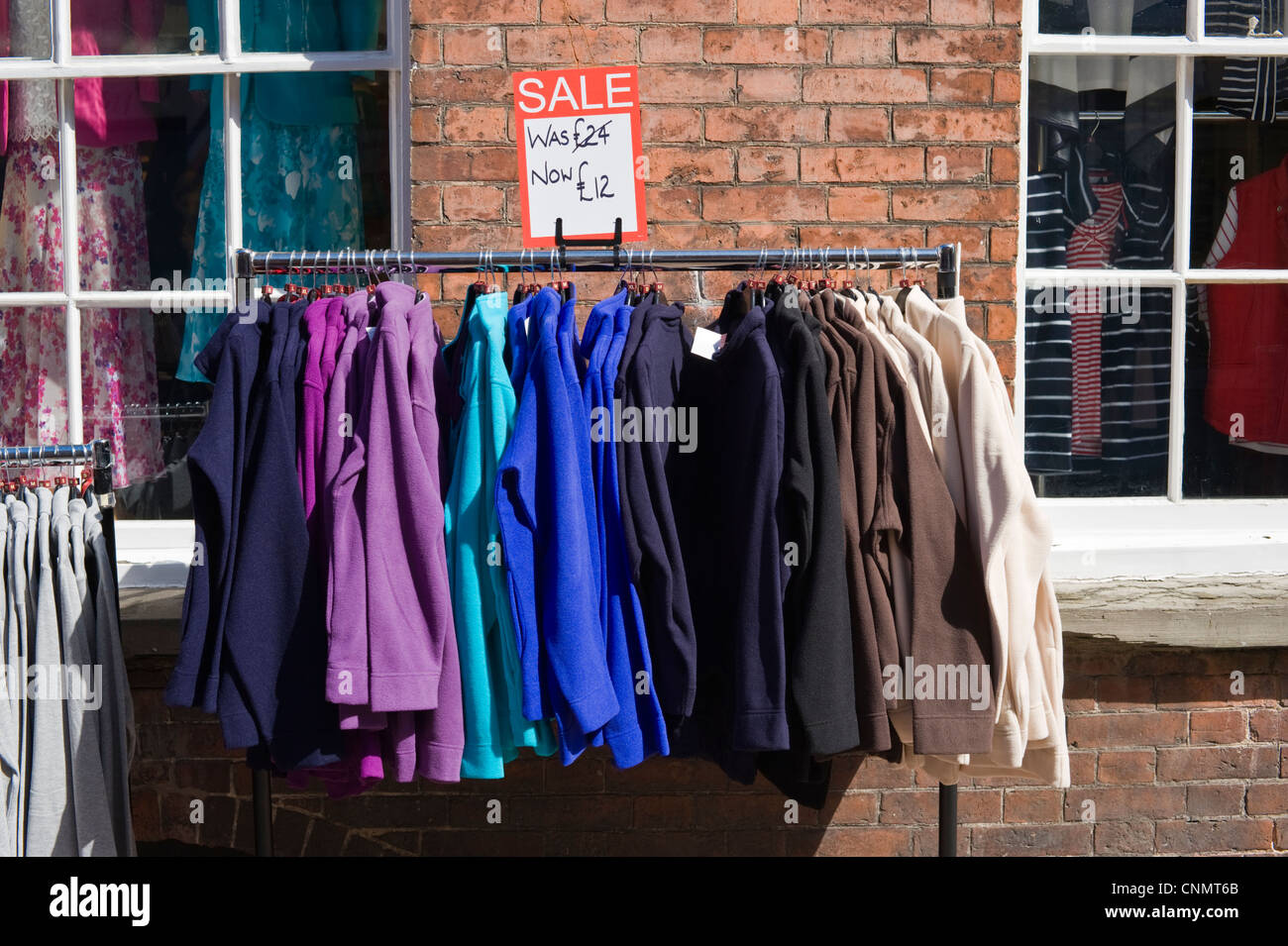 Half Price Clothing Sale On Rail Outside Shop In City Centre Of Hereford  Herefordshire England UK