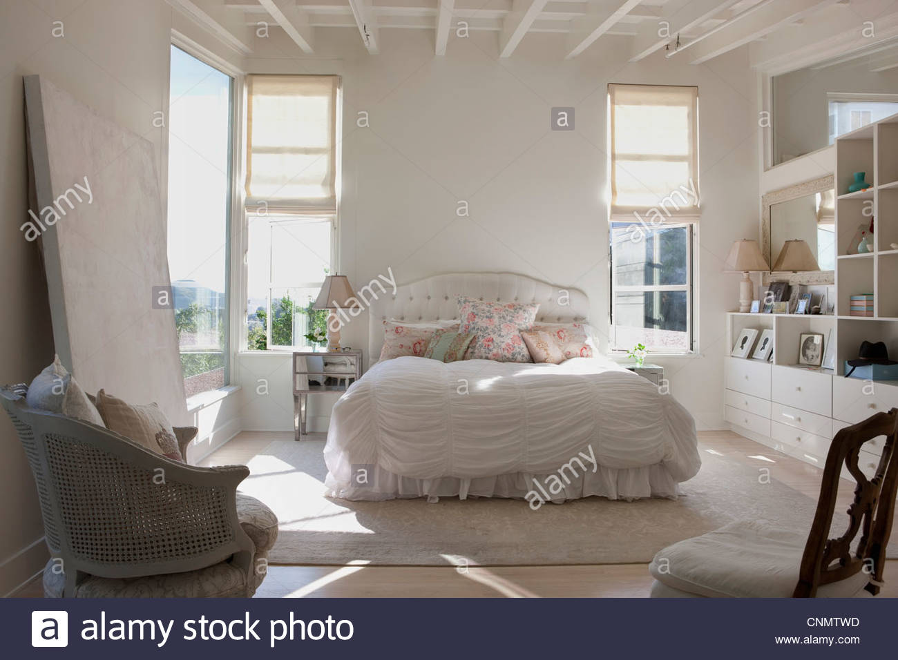 Chairs and bed in ornate bedroom - Stock Image