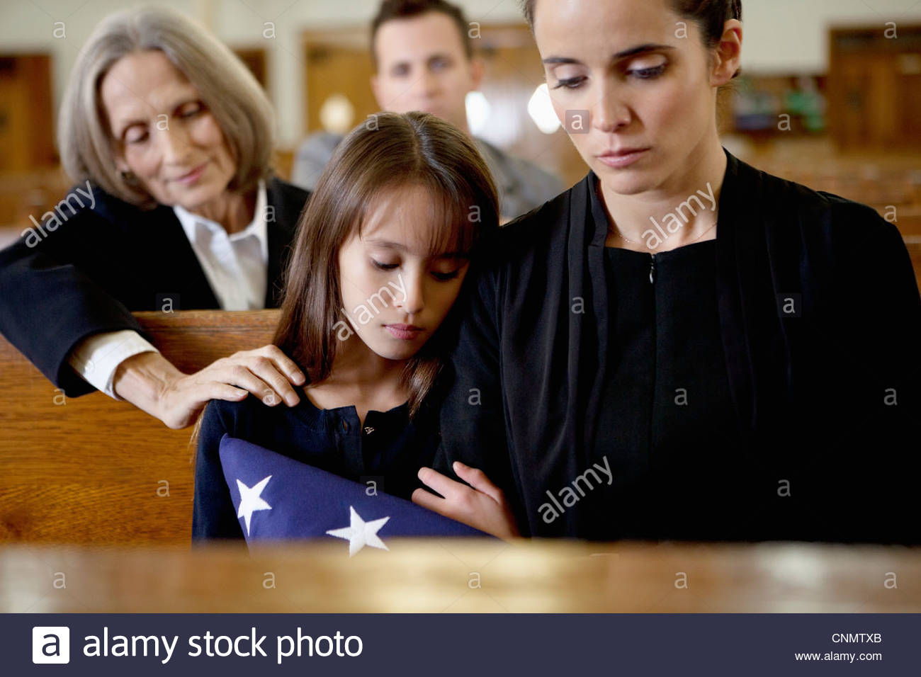 Mother and daughter at military funeral - Stock Image
