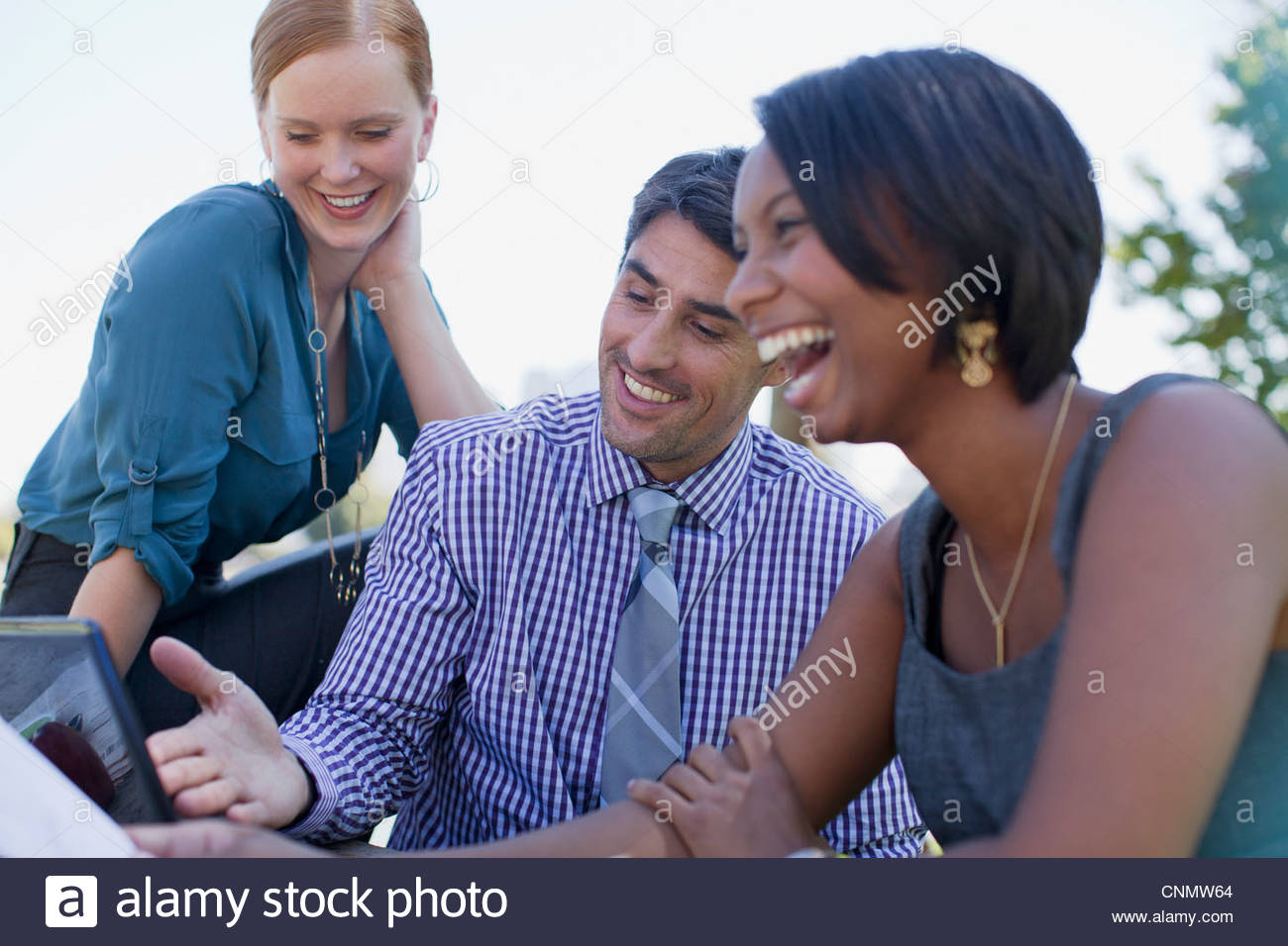 Business people working in park - Stock Image