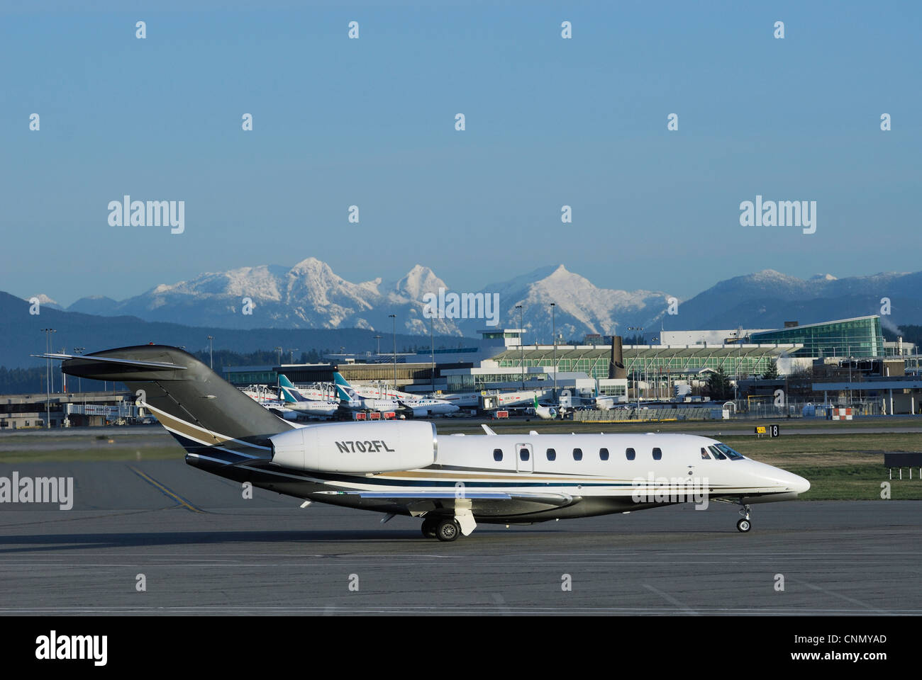 N702FL Cessna Citation X twin jet taxiing down the runway at the Vancouver International Airport. - Stock Image