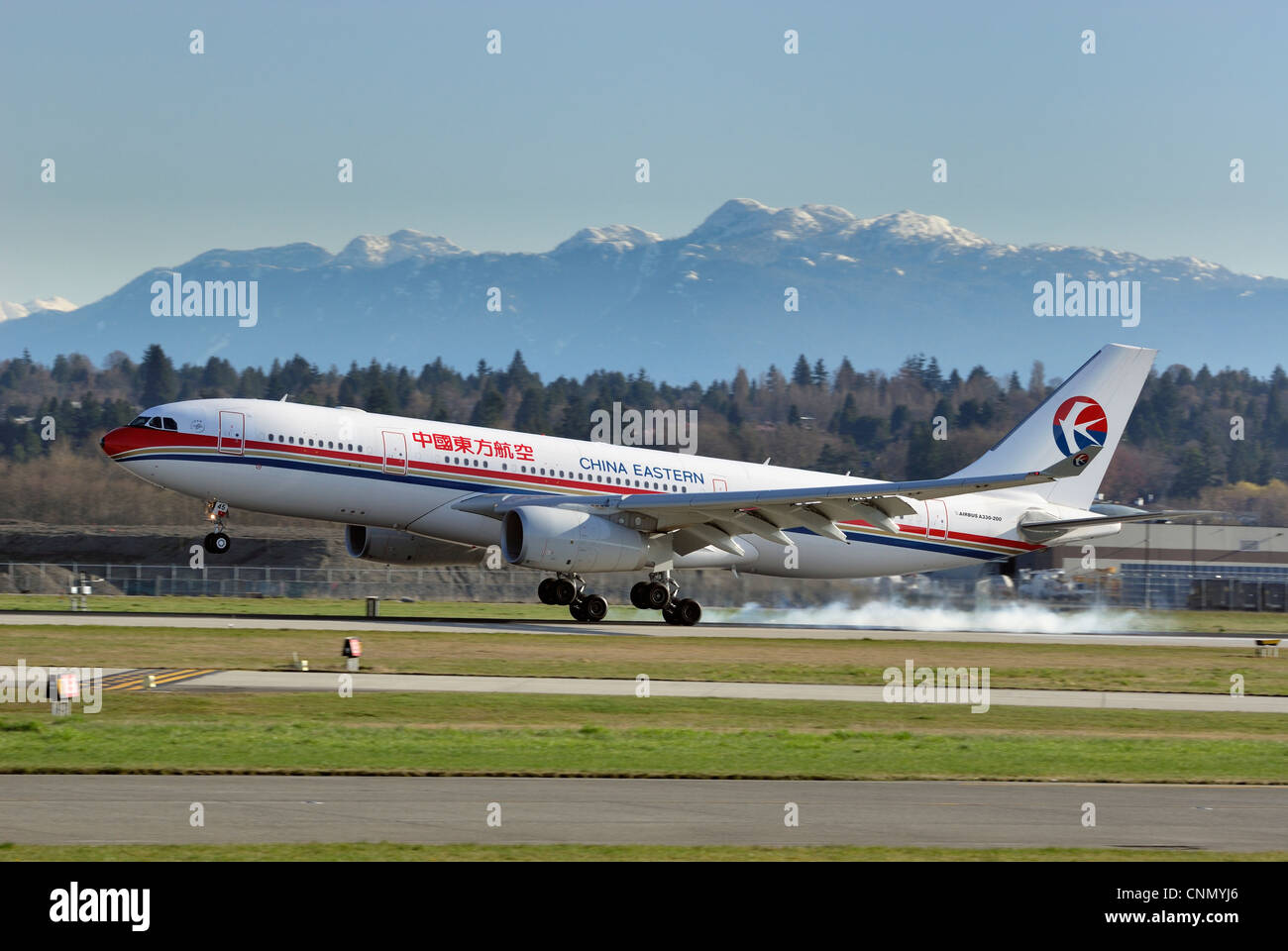 China Eastern Airbus A330 (200) landing at Vancouver International Airport. - Stock Image