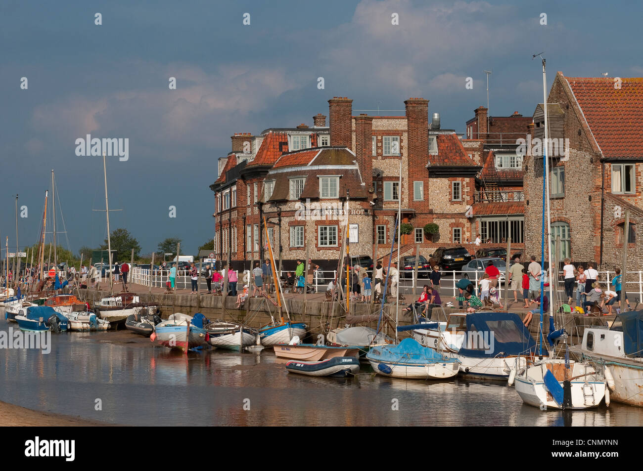 Holidaymakers and boats at Blakeney, Norfolk, East Anglia, England. - Stock Image