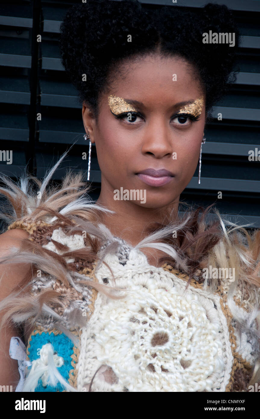 London Alternative Fashion Week 2012  .Black model wearing crochet and feathers on top. - Stock Image