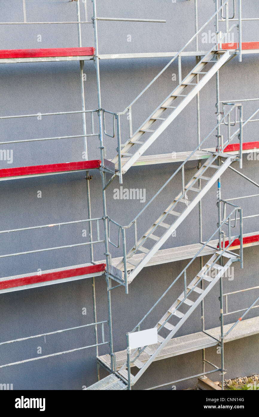 symmetrical scaffolding construction of tree stories connected with flights of stairs Stock Photo