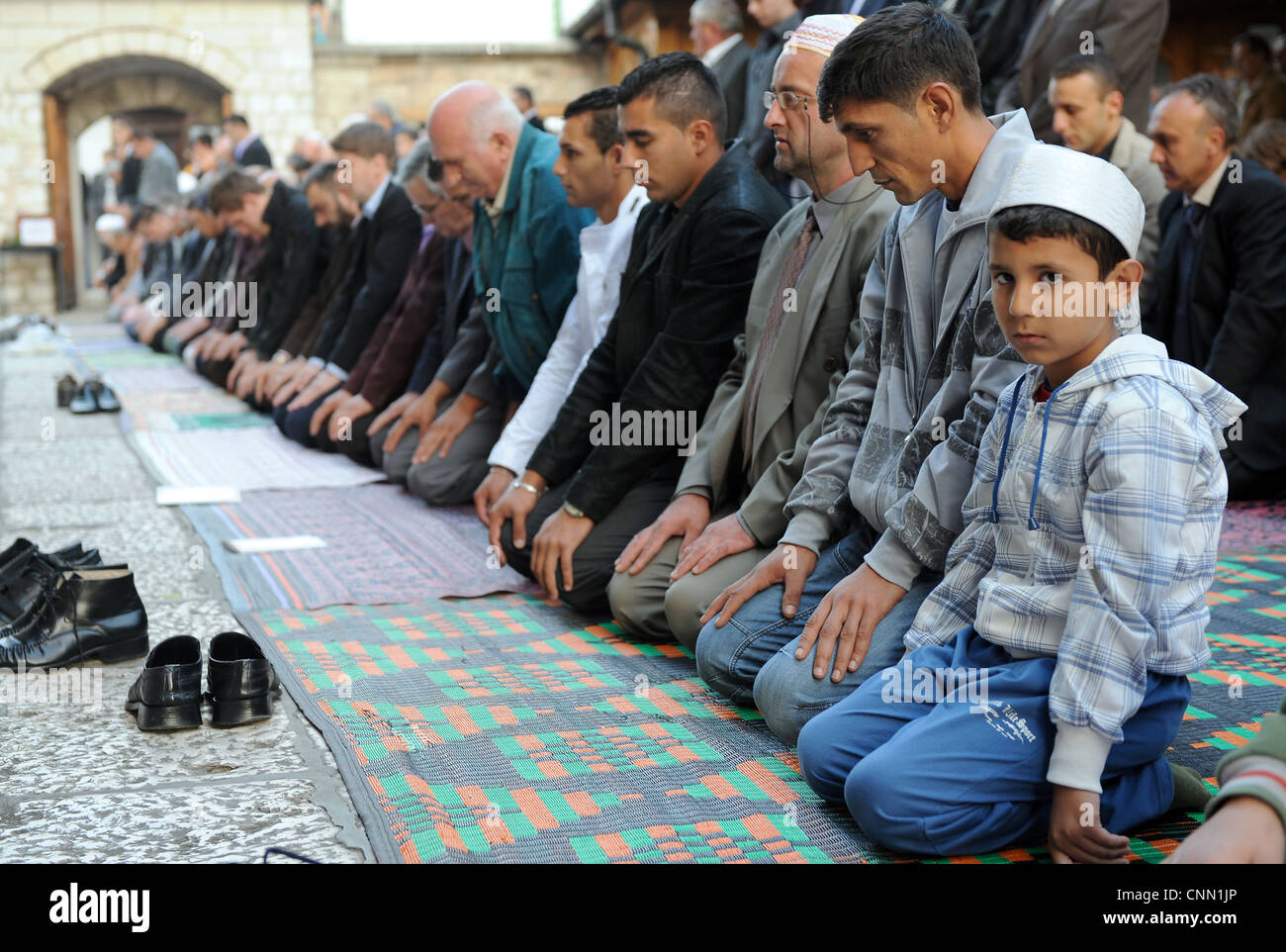 Bosnian Muslims pray in Sarajevo, celebrating the biggest Islamic religious holiday Eid AL -Adha. - Stock Image