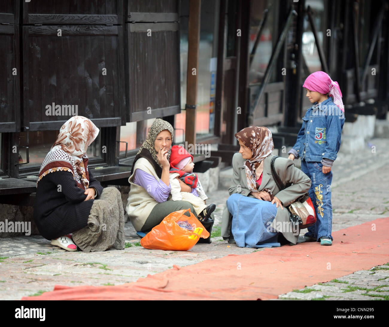 Beggars in old Turkish quarter of Bosnian capital Sarajevo. - Stock Image