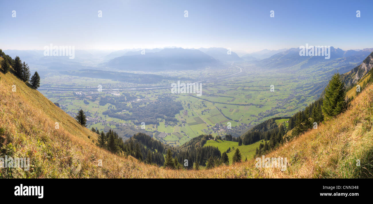 panorama view over the border plain of Switzerland and Liechtenstein in morning mist veil with river Rhine - Stock Image