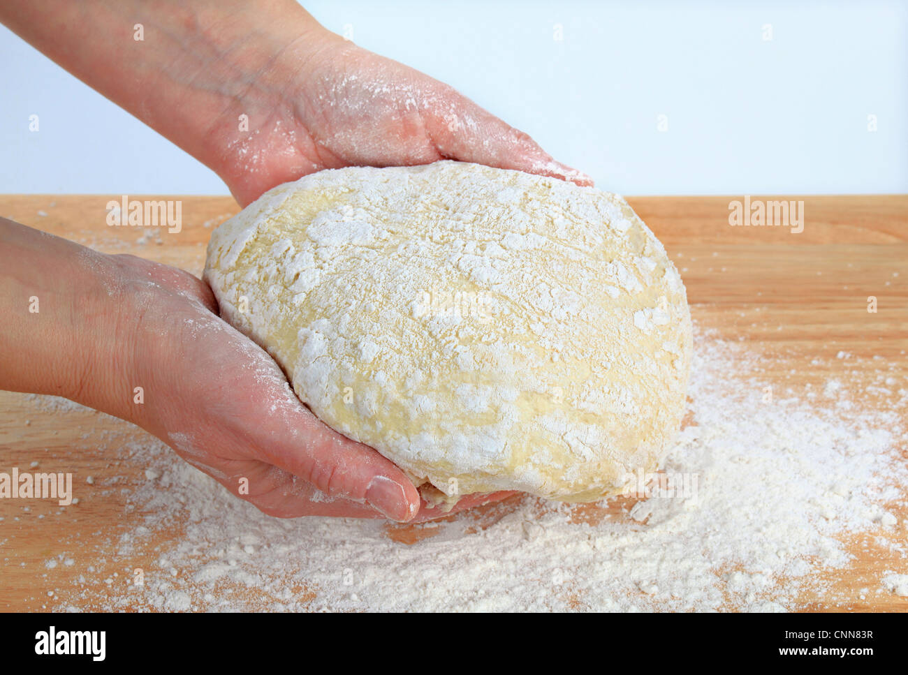 Cook making yeast pizza dough - Stock Image