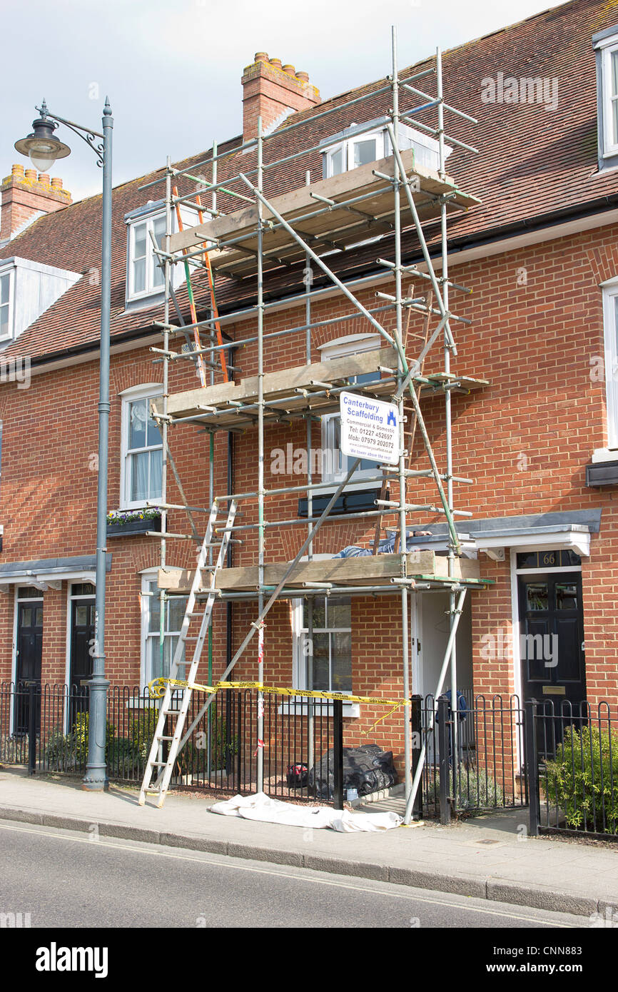Scaffold Scaffolding Painting and decorating on small modern house. - Stock Image