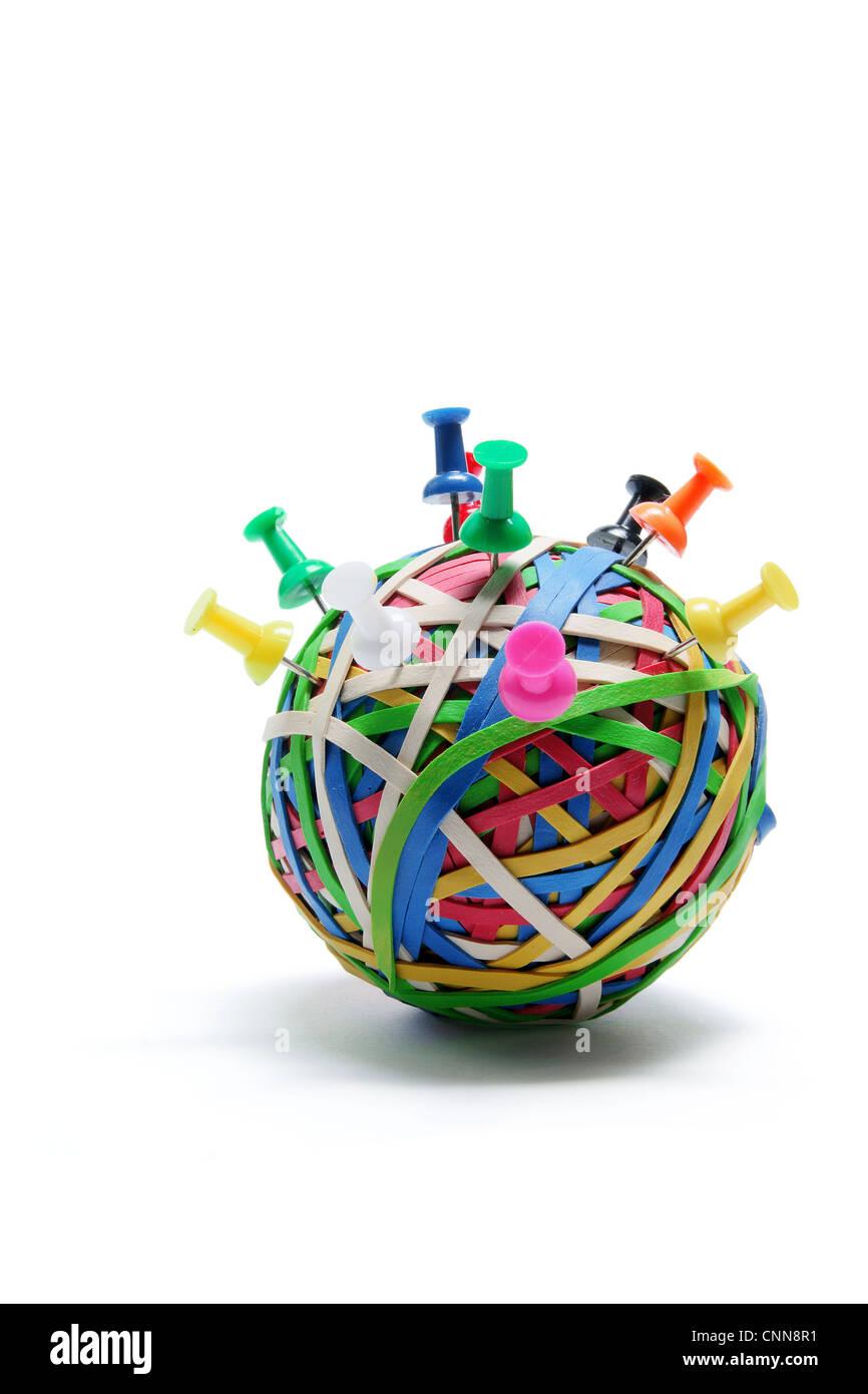 Pushpins on Rubberband Ball - Stock Image