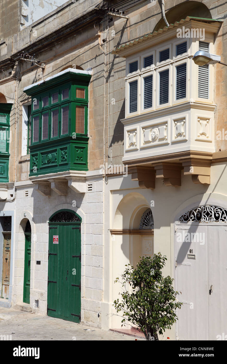 Two traditional Maltese houses with characteristic projecting bay windows or covered balconies, Rabat Malta, Europe - Stock Image