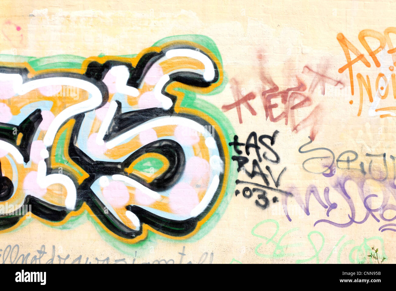 Vandalism on a wall - Stock Image