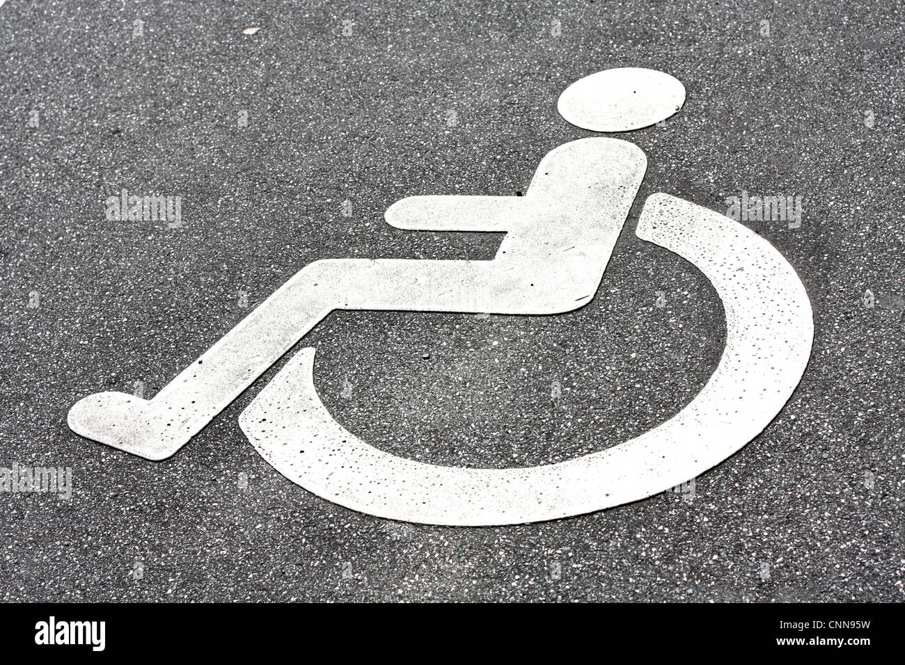 A disability logo in the road - Stock Image