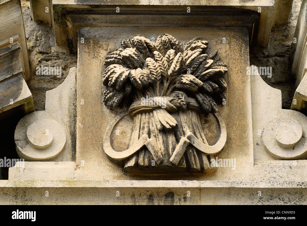Corn sheaf sign outside the Corn Exchange in Thrapston, Northamptonshire - Stock Image