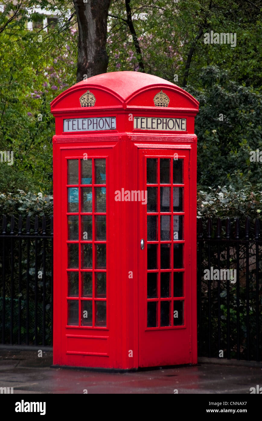 A traditional red telephone box (K2 model) in London, England, UK - Stock Image