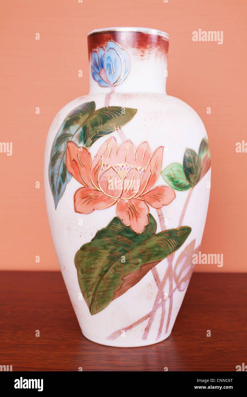 Vintage etched glass vase with flower and leaf design. No markings except a number 5. - Stock Image