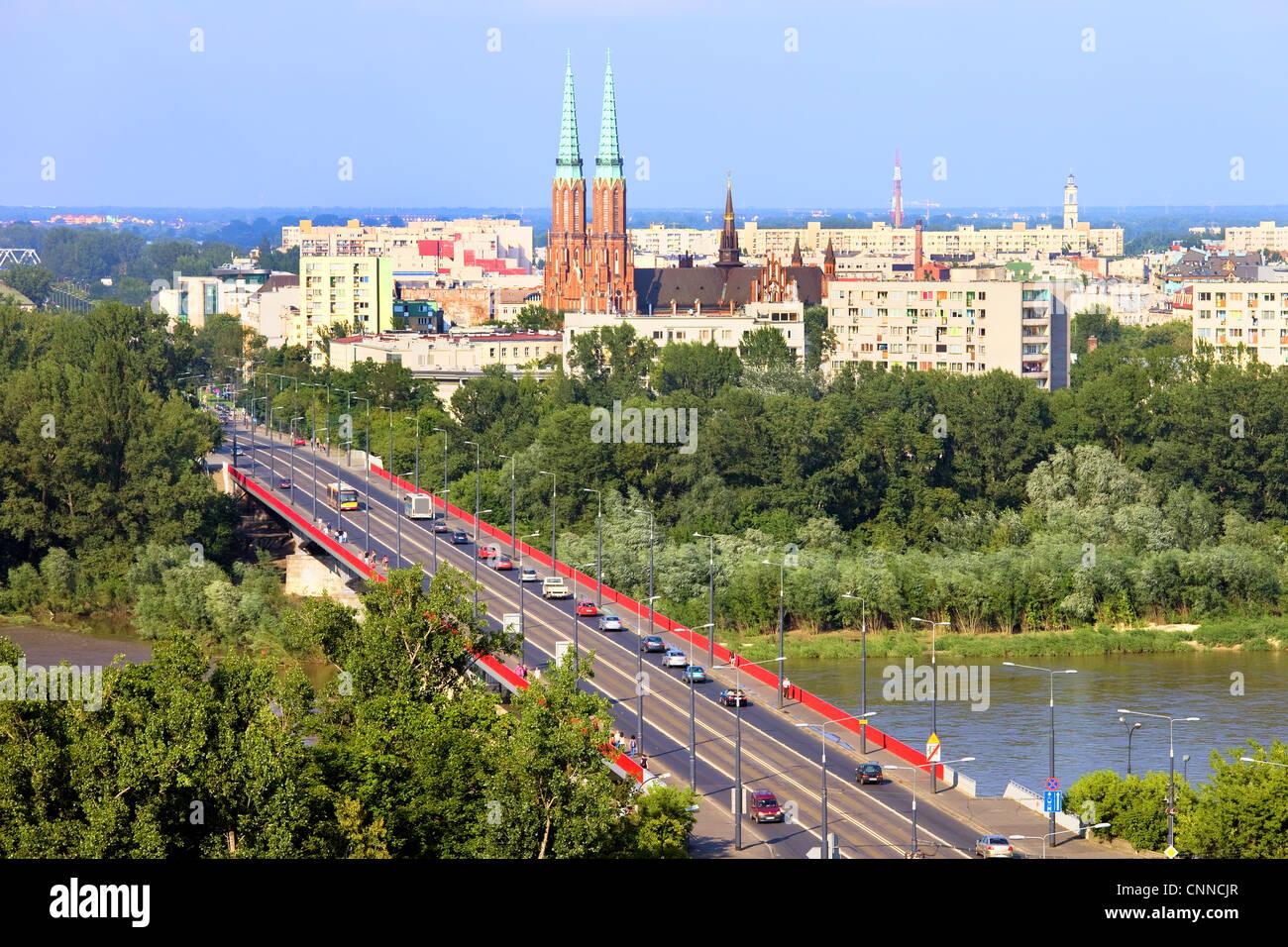 Cityscape of Warsaw, Poland, Slasko-Dabrowski bridge, Praga district behind the Vistula river - Stock Image