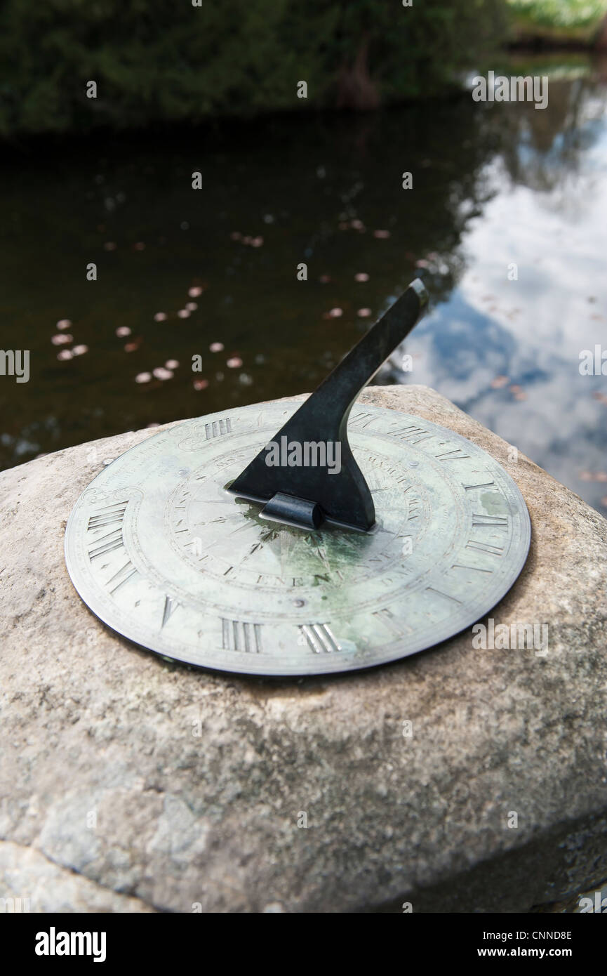 sun dial in a park - Stock Image