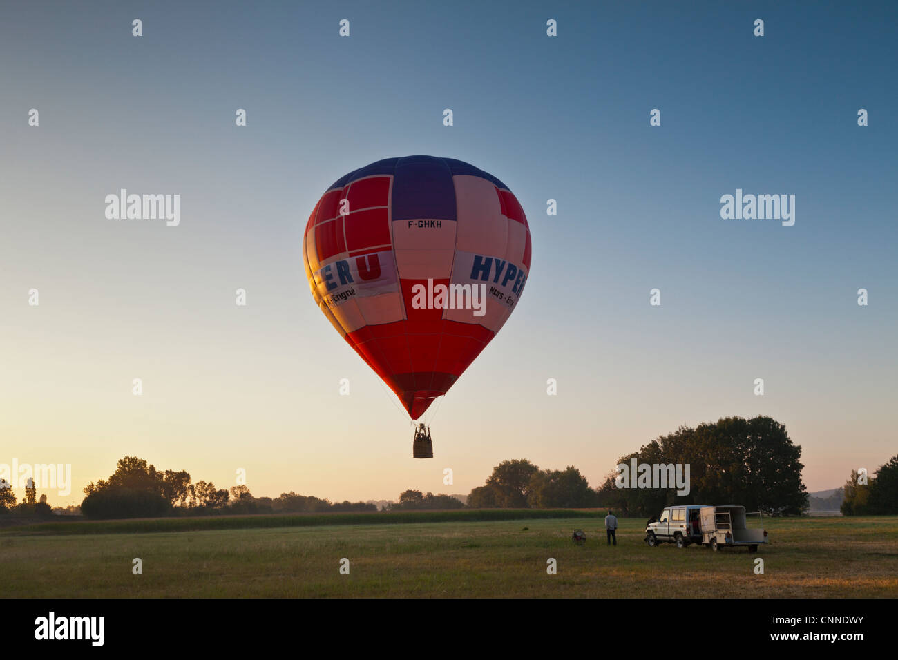 Hot-air balloon or Montgolfiere, ascends at dawn for a flight over the Loire Valley near la Dagueniere. Stock Photo