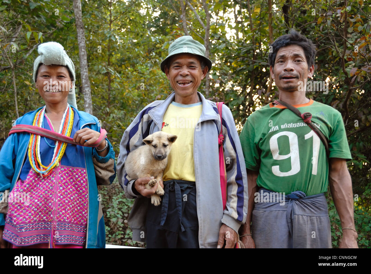 Karen hilltribe family on the way into Mae sariang on 14/02/2009 in Mae sariang Thailand - Stock Image