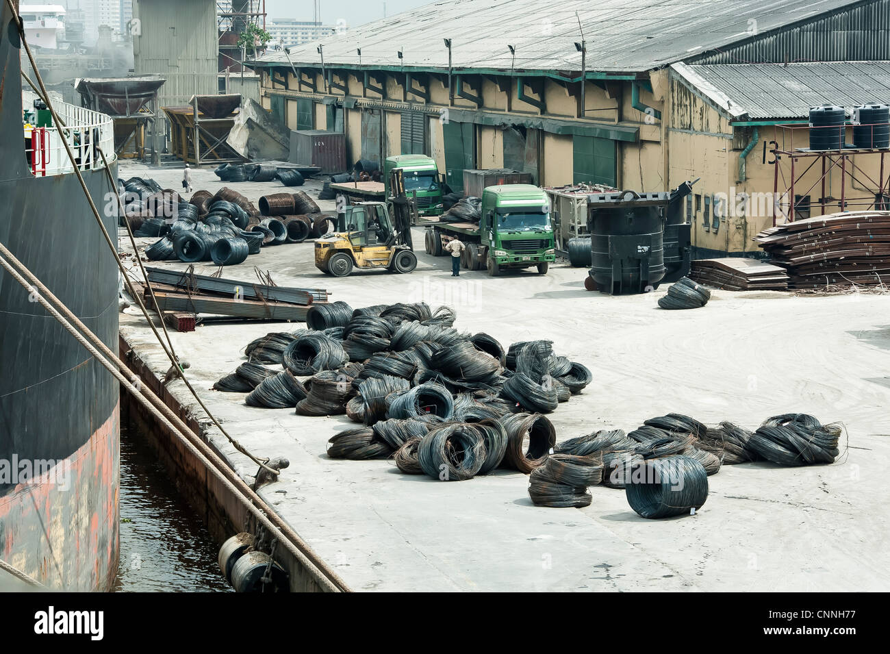 Bulk cargo on a dock in Nigeria - Stock Image