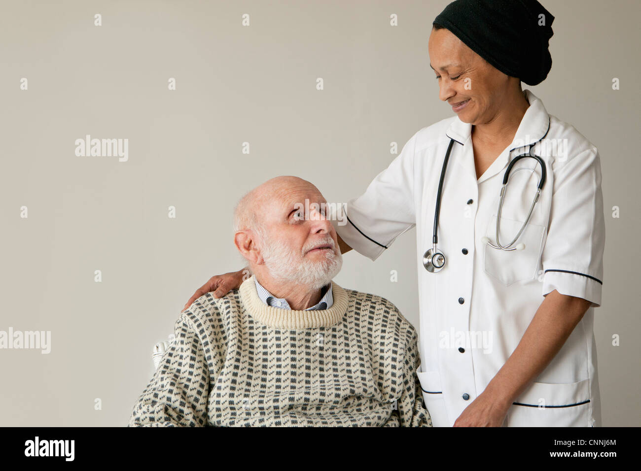 Caretaker smiling with older man Stock Photo