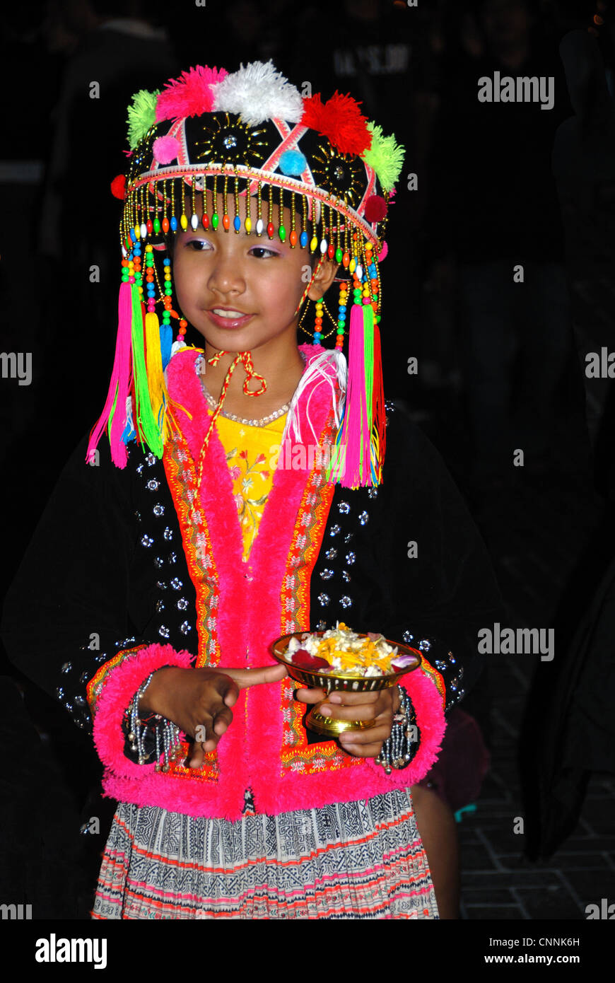small mong hilltribe child dancing in the the sunday market on 14/12/2008 in chiang mai Thailand - Stock Image