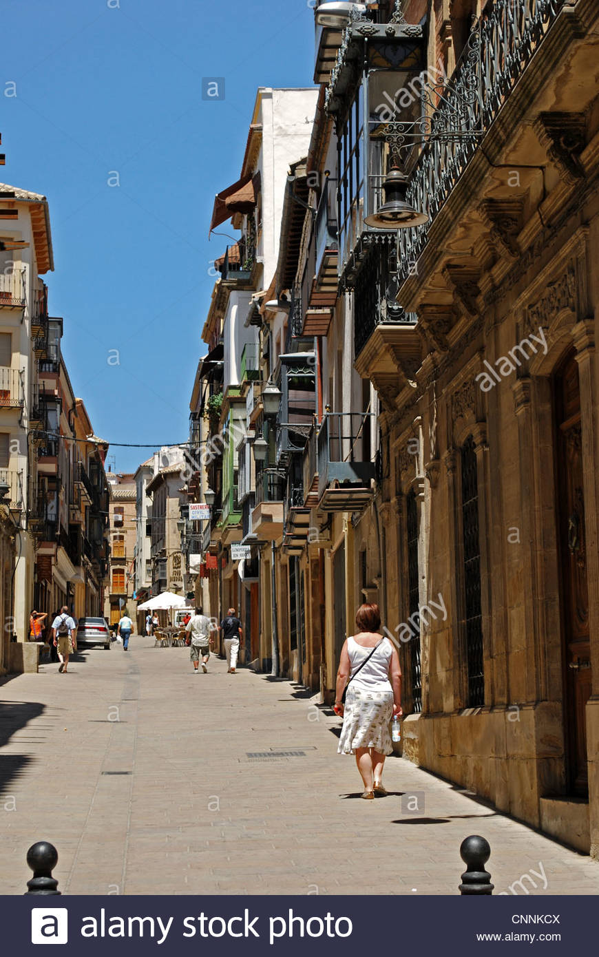 Old stone houses and shops in narrow street, Ubeda, Jaen Province, Andalucia, Spain, Western Europe. Stock Photo