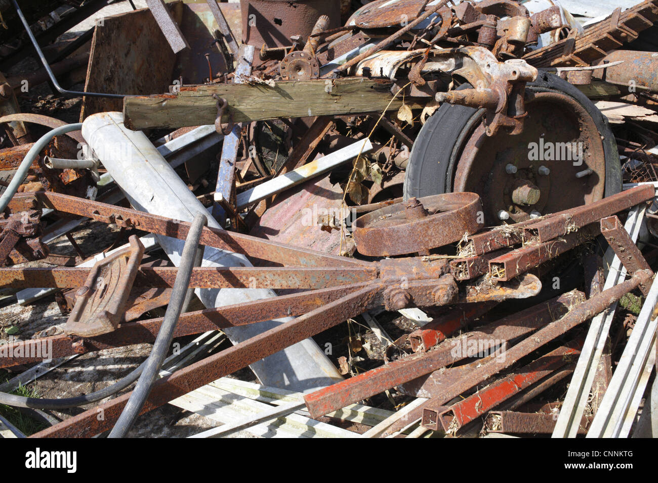 Assorted scrap metal on farm, awaiting collection for recycling, Powys, Wales, july - Stock Image