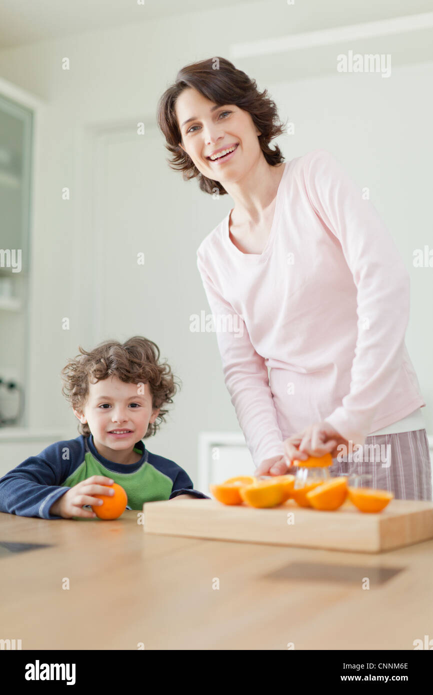 Mother and son having breakfast - Stock Image