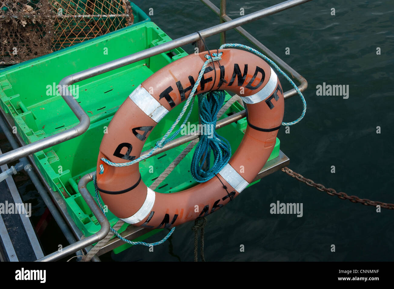 Lifebelt on a boat moored in the harbour at Wells Next The Sea, Norfolk, East Anglia, England. - Stock Image