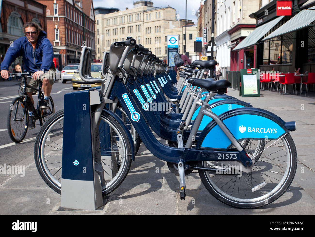A bicycle docking station as part of the new London's Barclay's bicycle hire scheme, Commercial street, - Stock Image