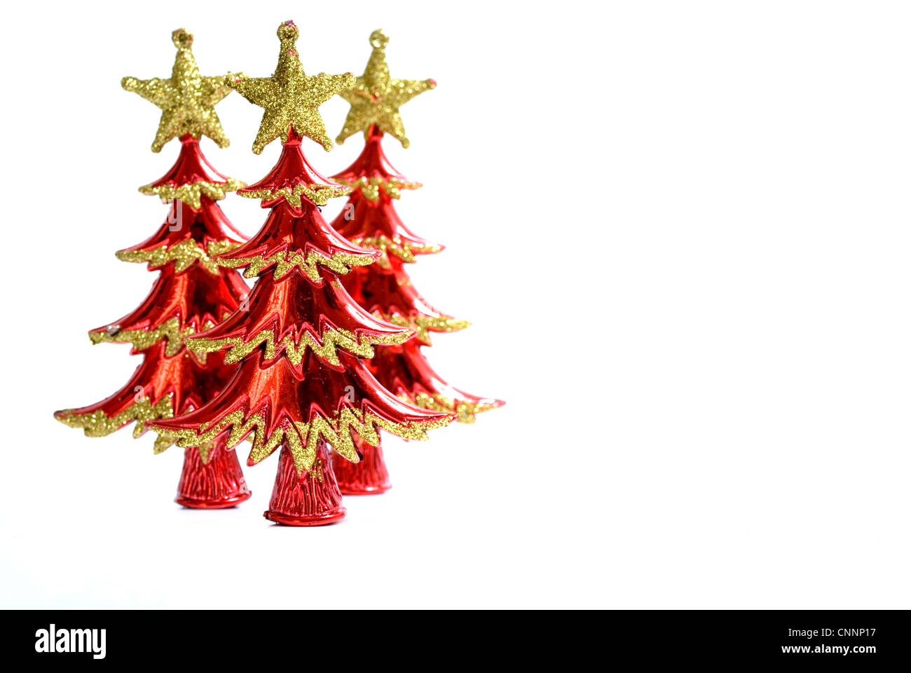 Three Christmas Tree Ornaments on a white background, text area. - Stock Image