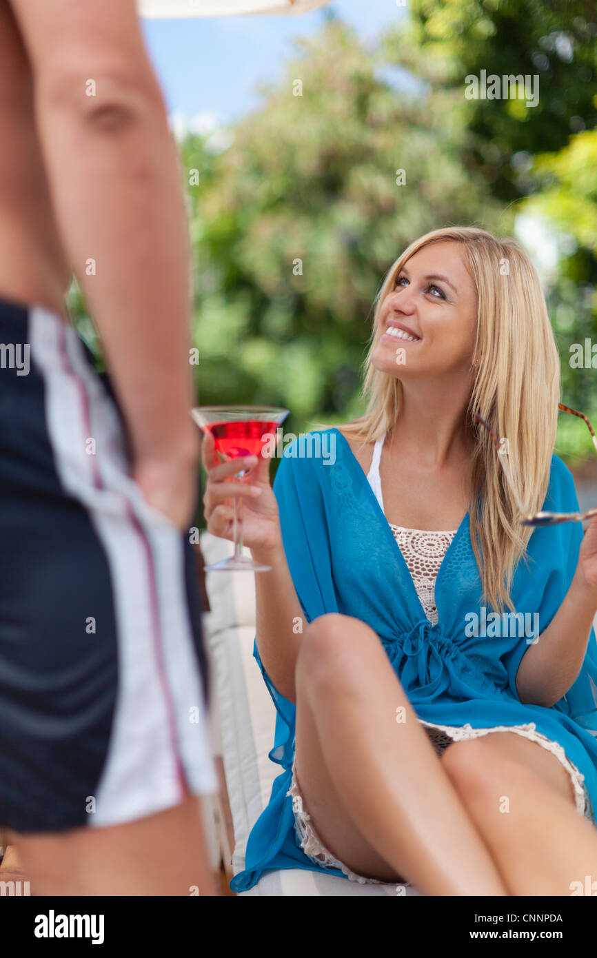 Smiling woman looking at boyfriend - Stock Image