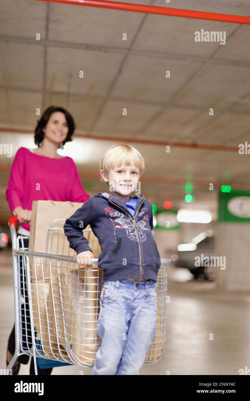Mother grocery shopping with son - Stock Image