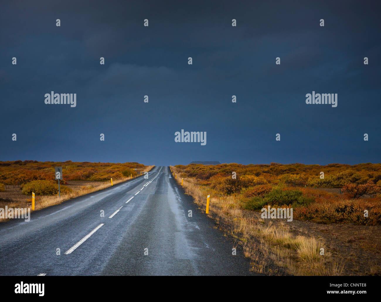 Dark Clouds over Road, Vesturland, Iceland Stock Photo