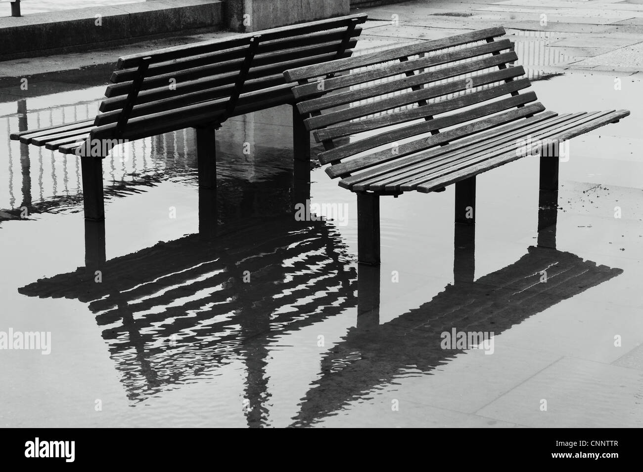 Benches and puddles, London - Stock Image