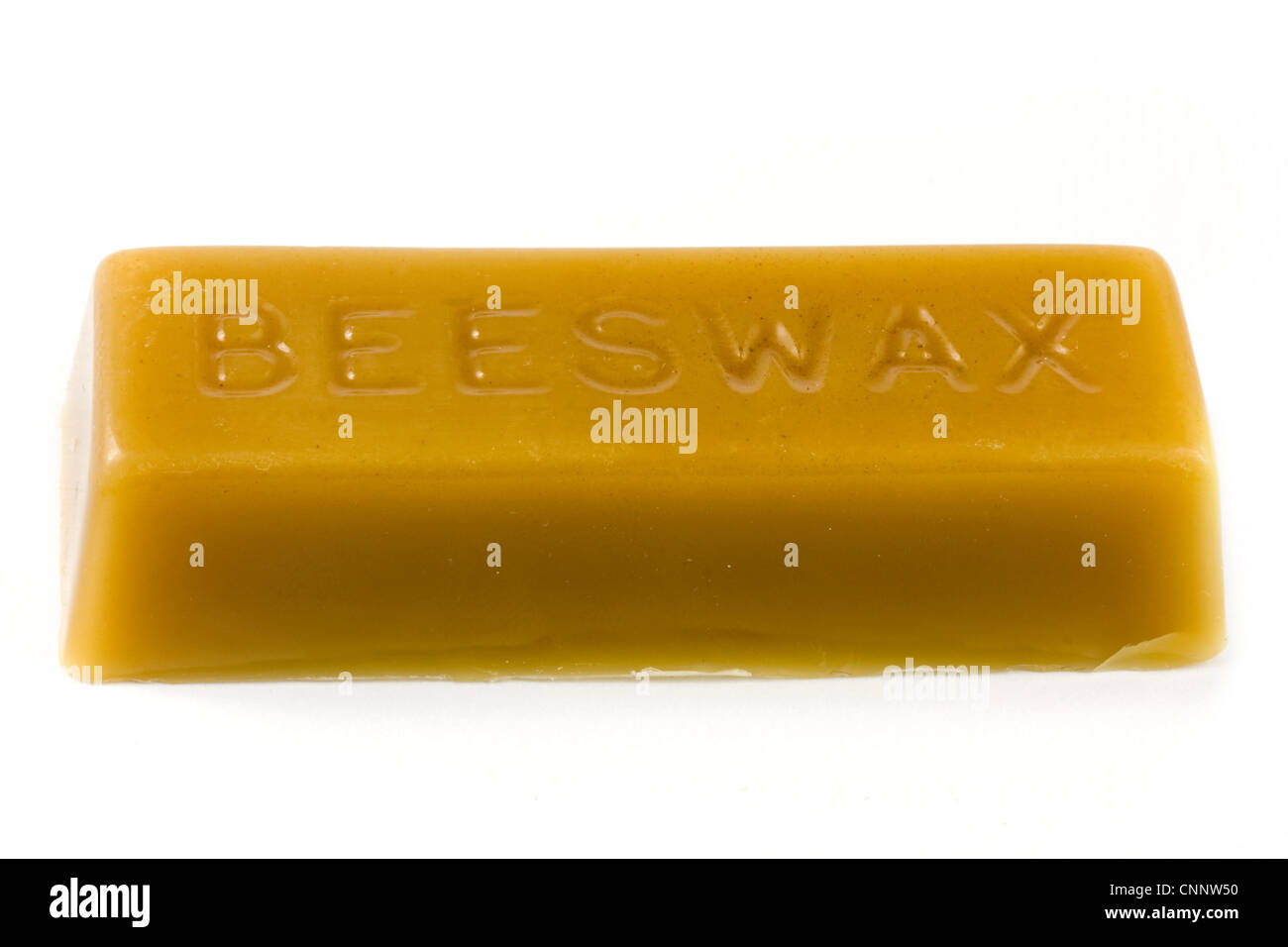 Stick of beeswax over white - Stock Image
