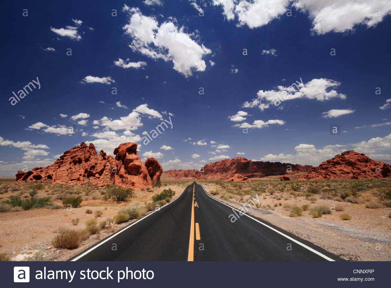 Rock formations along rural road Stock Photo