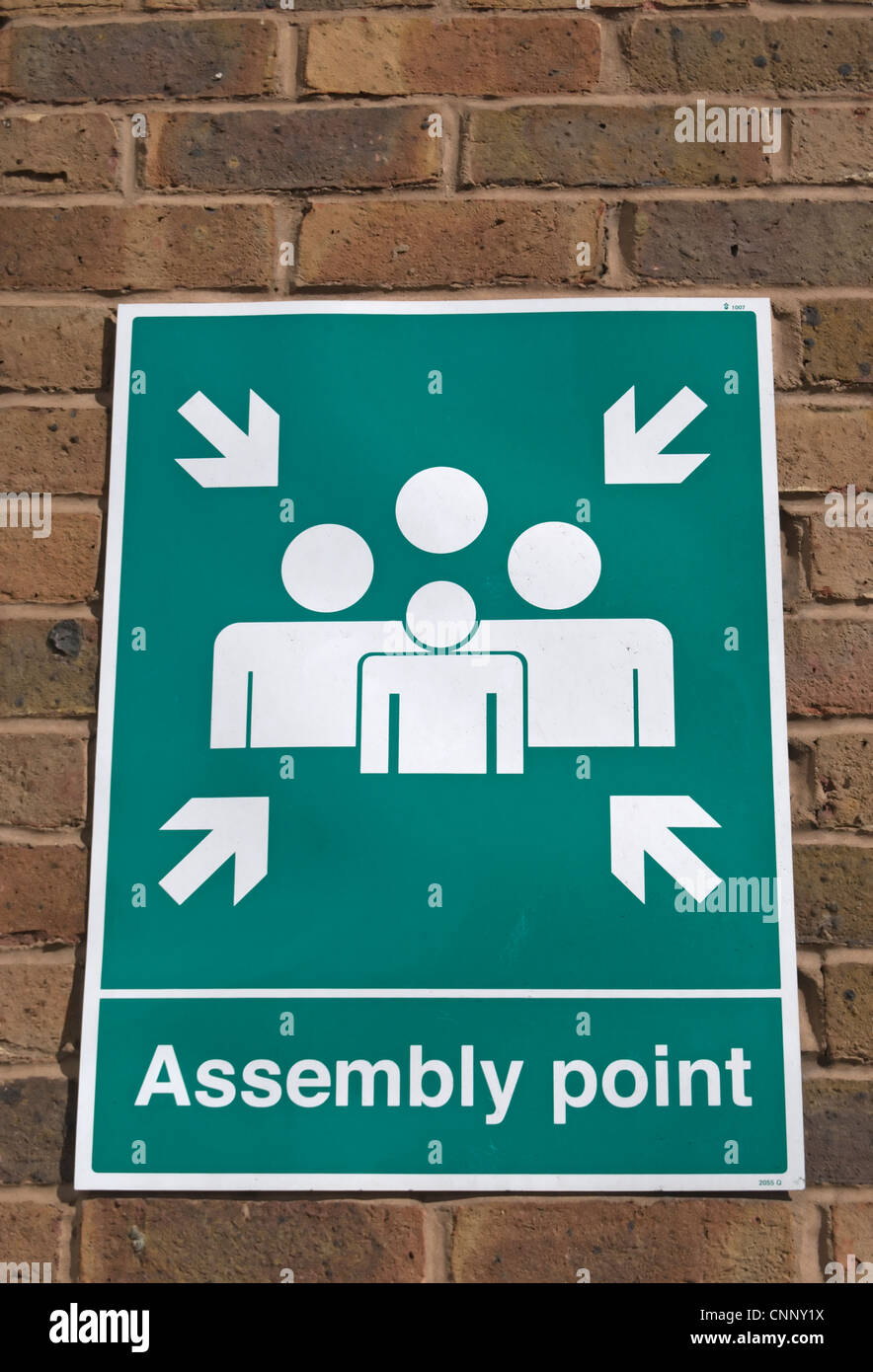 assembly point sign on a building in kingston, surrey, england - Stock Image