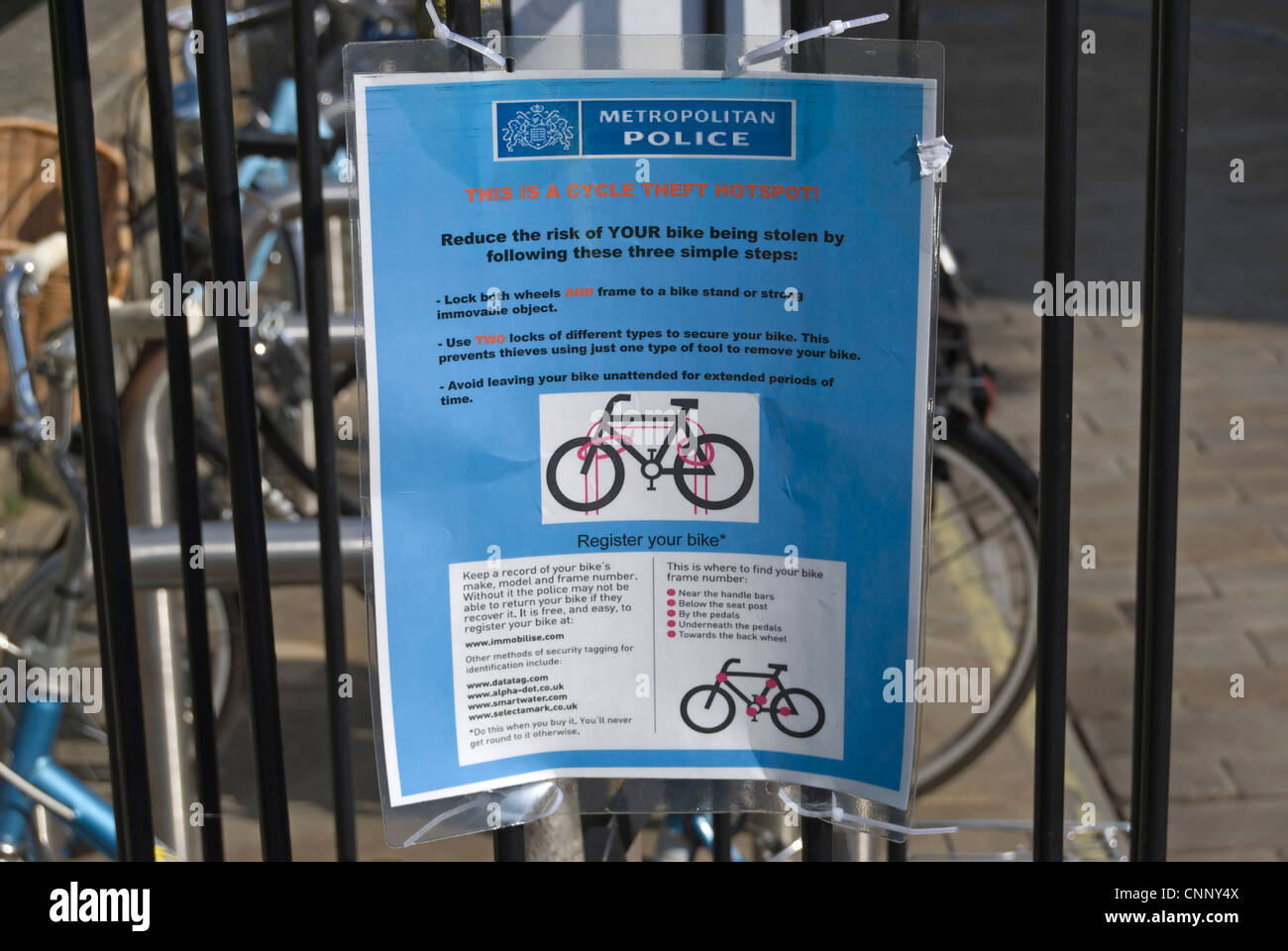 metropolitan police sign warning of a cycle theft hotspot, in kingston, surrey, england - Stock Image