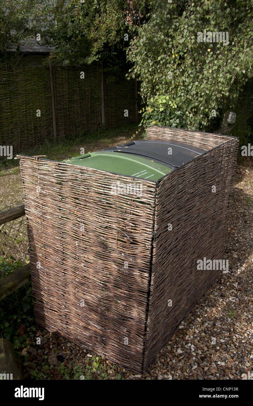Willow Enclosure Used To Screen Wheelie Bins In Garden, England, September    Stock Image