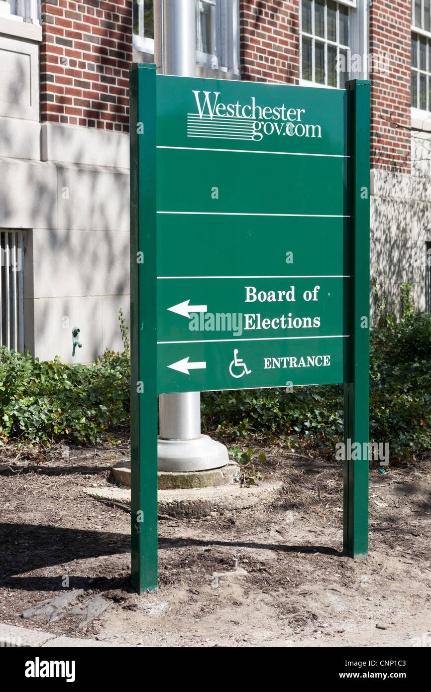 A sign points to the entrance to the Westchester County Board of Elections in White Plains, New York. - Stock Image